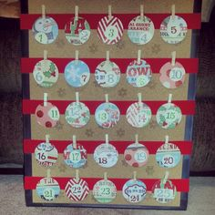 Advent calendar using a cork board, ribbon, scrapbook material and mini clothes pins