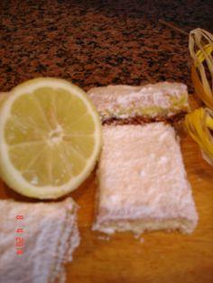 http://favoleamerenda.blogspot.it/2014/04/quadrotti-al-limone.html