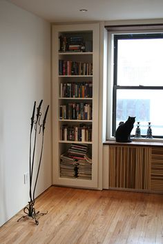 Built-in Bookshelves and Radiator Cover (Designed by www.petermaslow.com) by kdkaboom, via Flickr