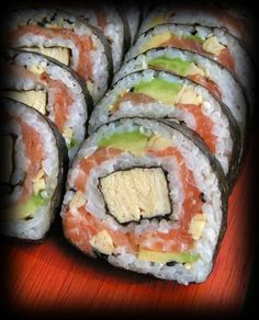 """Futomaki (太巻, """"thick, large or fat rolls"""") is a large cylindrical piece, with nori on the outside.[13] A typical futomaki is five to six centimeters (2–2.5 in) in diameter.[14] They are often made with two, three, or more fillings that are chosen for their complementary tastes and colors. During the evening of the Setsubun festival, it is traditional in the Kansai region to eat uncut futomaki in its cylindrical form, where it is called ehō-maki (恵方巻, lit. happy direction rolls)."""