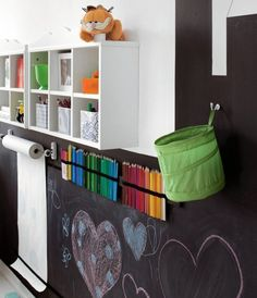 Love this idea!!  Chalkboard wall and wall storage.