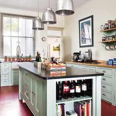 Go retro cool in your kitchen by painting cabinets a pale sage green reminiscent of vintage jadeite dishware. Shown here: Behr Premium Plus Ultra interior semigloss acrylic latex in Frosted Jade. | Photo: Colin Poole/IPC Images | thisoldhouse.com