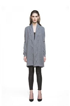 Let your knitwear do the talking when you layer this show-stopping cardigan over chic or off-duty looks. Boasting a beautiful trim with dimensional texture, this cozy cashmere cardigan offers added warmth without feeling bulky at all. Balance the fluid fit with skinnies and sexy heels.