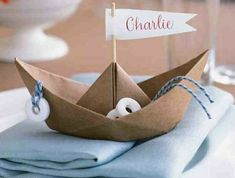maritime summer decoration as table decoration hochzeiz sailing vessel made of cardboard - basteln - Summer Decoration, Decoration Table, Cumple George Pig, Gallery Frames, Knit Pillow, Rattan Basket, Cozy Blankets, Nautical Theme, Fabric Covered