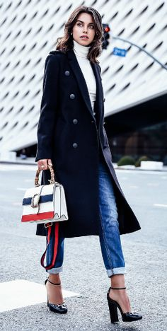 A military style jacket + must have this fall + cropped jeans + stilettos + turtleneck top + Annabelle Fleur + strikingly androgynous style.   Coat/Jeans: Rag & Bone, Bag: Gucci.