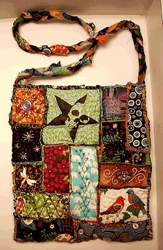 I just love these cute little totes this crafter makes. Those little squares could be made in the evening while watching TV. Imagine what you could do with a whole boxful of them!
