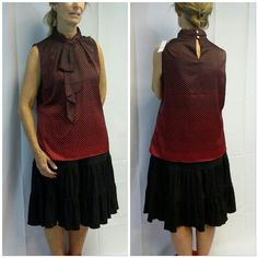 """Ruffled Front Sleeveless a red dots on Black Top Ruffled Front Sleeveless a red dots on Black Top, ruffle is sew on at top of neckline then free flowing down the front, collar is layered sideways pleated unique design,  A-line fit very flattering,  2 loop button key-hole back collar closure,  red dots are small at top then grow larger going down to hem. 97% polyester,  3% spandex,  26 1/2"""" length shoulder to hem, 21"""" bust laying flat,  New With Tag, 43% off retail of $43, great top to bundle…"""