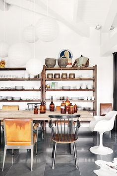 Rustic kitchen with tall shelves for all kitchen accessories