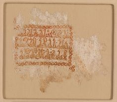 Textile Fragment with Inscription Object Name: Fragment Date: 10th–11th century Geography: Iraq Culture: Islamic Medium: Cotton, gold, ink; ...