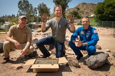 Actor Matt Damon smiles after having made his hand prints in cement at the JPL Mars Yard
