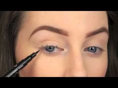 She Starts By Drawing A Few Small Dots Above Her Lashes. When She Fills Them In? Amazing!