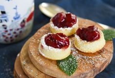"""These mini cherry """"bombs"""" made of olive oil cake and cherry sauce with raspberry liquer pack a punch!  #cake #oliveoilcake #cherries #cherrysauce #afternoontea #teatime Cherry Liqueur, Cherry Sauce, Cherry Tart, Layered Deserts, Cherry Bombs, Cherry Brandy, Olive Oil Cake, Frozen Cherries, Moist Cakes"""