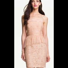 """Donna Morgan Lace Strapless Peplum Cocktail Dress New With Tags Womens Donna Morgan Dress  Cocktail Formal Womens Size 10 Strapless Peplum   Light Pink Lace Peach Cream  Shell 100% nylon Combo 100% polyester Lining 100% acetate  Length 29"""" Bust 34"""" Waist 31"""" Hips 41"""" Donna Morgan Dresses"""