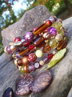 Check out this item in my Etsy shop https://www.etsy.com/ca/listing/178283683/bead-bracelets-in-gold-purple-crimson