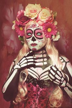 Pink!!! I love this sugar skull makeup, body paint, and flower crown. - 12 Day of the Dead Makeup Finds