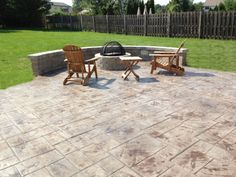 Stamped Concrete Patio with Pavers Sitting Wall and Pavers Fire Pit