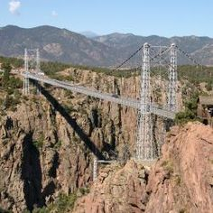 The Royal Gorge Bridge is a tourist attraction near Cañon City, Colorado, within a 360-acre (150 ha) theme park. The bridge deck hangs 955 feet (291 m) above the Arkansas River, and held the record of highest bridge in the world from 1929 until 2001, when it was surpassed by the Liuguanghe Bridge in China.