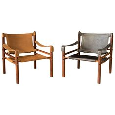 Vintage Sirocco Safari lounge chairs in rosewood designed by Arne Norell for Möbel AB, Sweden. Features the original handstitched slings in black and natural tan leather accented with brass hardware. Price is for each, please specify color. Lounge Chair Design, Lounge Chairs, Leather Lounge, Tan Leather, Modern Armchair, Modern Materials, Chair And Ottoman, Interior Design, Furniture