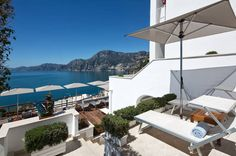5 Luxury European Getaways | Perched on the cliffs in Praiano on Italy's Amalfi Coast, Casa Angelina Lifestyle Hotel is luxurious and full of stylish simplicity that offsets the natural beauty of its surroundings. Understated chic is at the heart of this hotel, with crisp white interiors, modern art and fine touches throughout. The outdoor pool overlooks the ocean, while one of the hotel's private boats can be chartered to explore the local area. With a rooftop restaurant that serves gourmet…