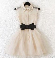 party dress with bow belt and pearl collar