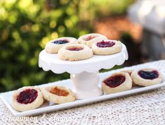 Josie's Jelly Cookies are tender shortbread cookies filled with your favorite flavor of jam, making them beautiful & elegant with the jeweled-toned center.