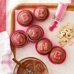 Top cupcakes with alphabet cookies to spell out sweet sentiments. More Valentine's Day goodies: http://www.bhg.com/holidays/valentines-day/recipes/valentines-day-treats/