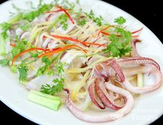 Vietnamese Squid Salad (Gỏi Mực) are very popular in Vietnamese salads but using squid is also common. I used already cleaned large squid tubes. The texture of the strips of squid really compliments the crunchiness of the salad. #salad #vietnamesesalad #vietnamesefood