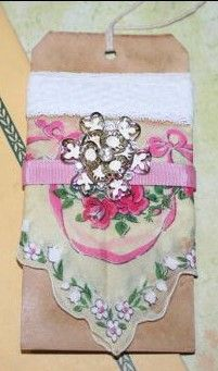 A gift tag-a good way to use an old hanky where maybe only the edge or corner still looks nice!