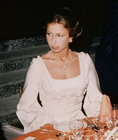 Princess Anne sitting in evening dress for a meal (1973).