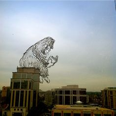 Garrett Miller doodles on glass windows with an expo marker to make this.