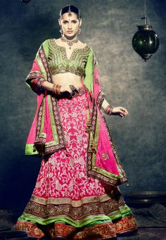 """""""Pink Net flared Semi Stitch lehenga designed with Resham,Zari,Stone & Patch Border work. A s shown in the photo Green Art silk choli is available.  INR:-14,750 -With Exciting 25% Discount !"""