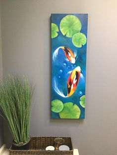 """""""Koi Fish"""" painted as a verticle on a 10x30 canvas by Sherry Mitchell, Sherry add Lily Pads which gives it a entire new feel. Great Job. The step by step video can be found on YouTube with this link; https://youtu.be/6O-cGfGc6qE"""