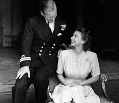 Princess Elizabeth (later The Queen) and Lieutenant Philip Mountbatten (later The Duke of Edinburgh) announce their engagement at Buckingham Palace, 9 July 1947. © PA
