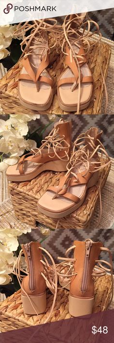 Jeffery Campbell Tan Lace Up Platform Sandals Brand new tan leather lace up Platform sandals from Jeffery Campbell! These are new but they have some discolorations on the straps and some small water spots. They also have some exposed adhesive in various places. Size 5. I'm not sure of the style name! Jeffrey Campbell Shoes Sandals