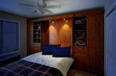 A custom designed Murphy bed by the Closet Works!