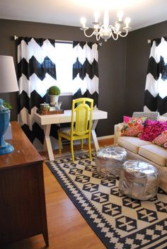 eclectic office. black and white drapes and rug. Pop of yellow with the chair