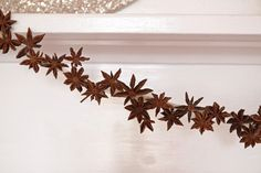 Last-Minute DIY: Holiday Garlands Made of Star Anise - Remodelista Patriotic Crafts, Holiday Crafts, Holiday Decor, July Crafts, Yule, Winter Christmas, Christmas Time, Stick Wreath, Primitive Christmas