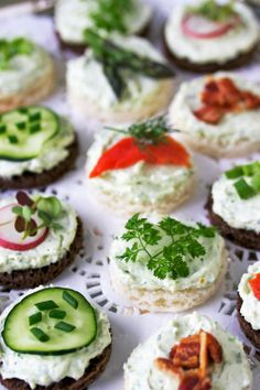 Tea Sandwiches garnished with chives, dill, parsley More