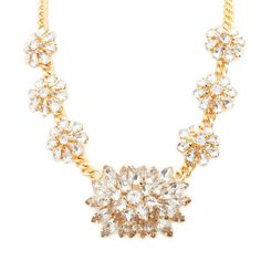 Make a bold and dramatic statement with this Kristine necklace. The bib is comprised of six crystal flowers and one oversized crystal flower. You will sparkle like a star!  Find it on Splendor Designs