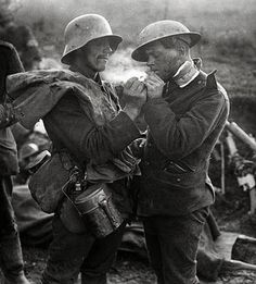 "A German and a British soldier share cigarettes during the Christmas Truce of 1914.  ""The Germans opposite us were awfully decent fellows – Saxons, intelligent, respectable-looking men. I had a quite decent talk with three or four and have two names and addresses in my notebook. […] After our talk I really think a lot of our newspaper reports must be horribly exaggerated."" -Fraternization Between the Lines, New York Times, 31 December 1914."