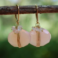 The pink opal wrapped earrings when worn will evoke joy into your life. - Pink opal nugget coin and 3 bead rose quartz ruffle - 14k gold filled leverback - Handcrafted in our studio of imported parts