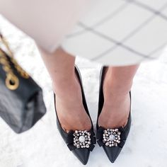 Classic black pumps and sparkly shoe clips sported by @krystin_lee! #TuesdayShoesDay from @ninewestcanada