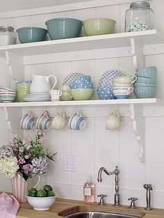 The light colored backdrop and the simplistic lines make this primitive vintage kitchenware pop.  The color palette is important when designing this in your kitchen.  Keep to only 2-3 colors for the biggest impact.  If this was red, black and white...you can see the contrast difference. Enjoy the idea!