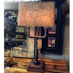 Industrial gas pipe lamp with on/off switch, cotton covered cord, and a solid oak base.