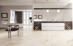 The look of the natural marble flooring in this room has a flowing appearance. This Kerlite Ultra Thin tile used is from the calacatta shade. #HIT #Design #Tile