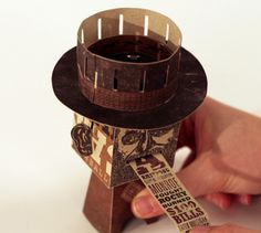An adhesive-free, mechanical papercraft toy with a zoetrope hat that spins to show an animation, and a retractable tongue. by Karissa Cardoza via dribble