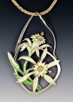 This gorgeous pendant is a Pancratium Maritimum, also called a Sea Daffodil. Kristin created this pendant using transparent vitreous enamel on sterling silver and it absolutely glows in the light Kristin Anderson, Vitreous Enamel, Daffodils, Plant Hanger, 18k Gold, Glow, Pendant Necklace, Sea, Gemstones