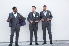 Los angeles outdoor wedding shoot at seventh place groom charcoal grey tuxedo with black shawl lapel and matching vest with white dress shirt and black bow tie with groomsmen charcoal grey tuxedos