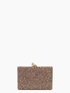 Love the glitter and the frog clasp on this clutch from Kate Spade