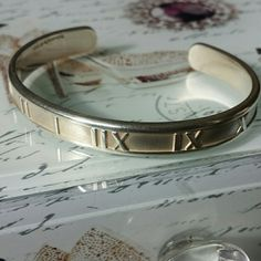 Tiffany & Co. Atlas Silver Cuff NO TRADES. NO PAYPAL. PRICE FIRM.  100% Authentic Italian Sterling Silver 925 Comes w/ box Used but still in good condition. Have scratches and small dents from normal use. Will fit small wrist. Tiffany & Co. Jewelry